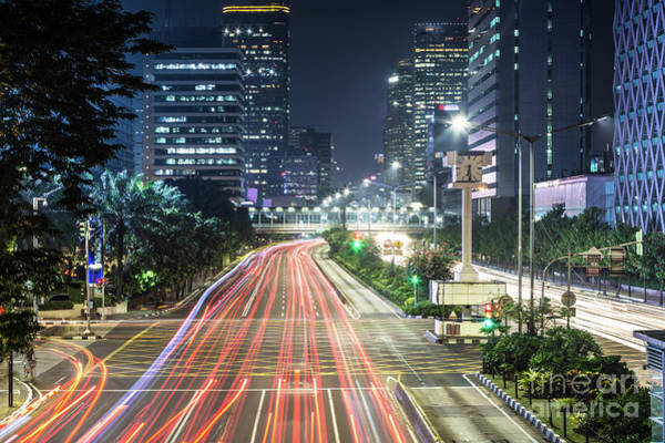 Photograph - Traffic Rush In Jakarta At Night by Didier Marti