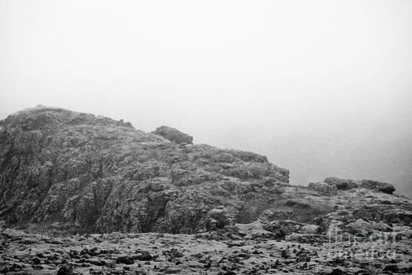 Troll Photograph - troll face in the volcanic lava field rocks Iceland by Joe Fox