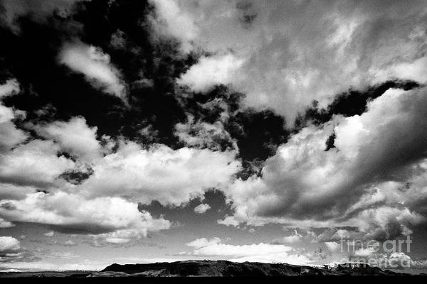 Wall Art - Photograph - white clouds in blue sky over open farmland in southern Iceland by Joe Fox