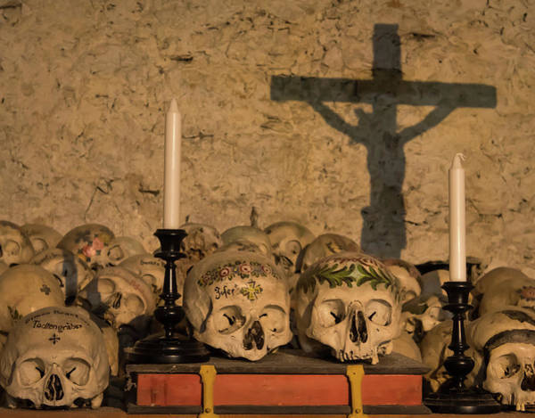 Charnel Photograph - Painted Skulls With Names, Candles And Cross by Stefan Rotter