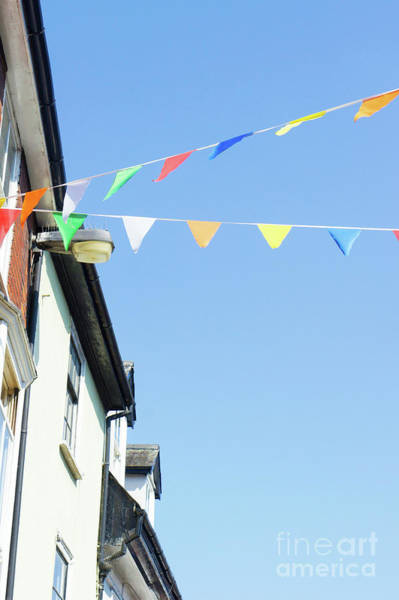 Wall Art - Photograph - Street Bunting Flags by Tom Gowanlock