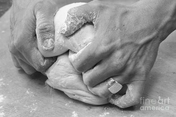 Toil Photograph - Hands Of A Baker Kneading Dough by Oren Shalev