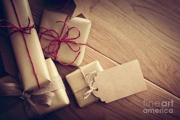Light Box Photograph - Rustic Retro Gift, Present Boxes With Tag. Christmas Time, Eco Paper Wrap. by Michal Bednarek