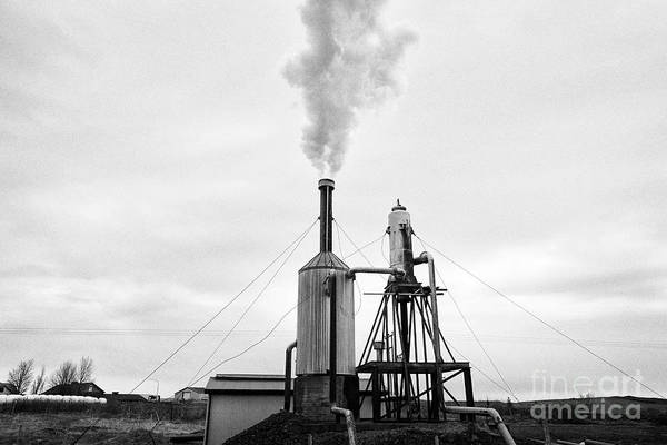 Wall Art - Photograph - small rural community geothermal energy plant rural southern Iceland by Joe Fox