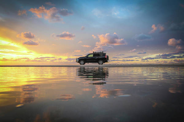 Photograph - 4wd Vehicle And Stunning Sunset Reflections On Beach by Keiran Lusk