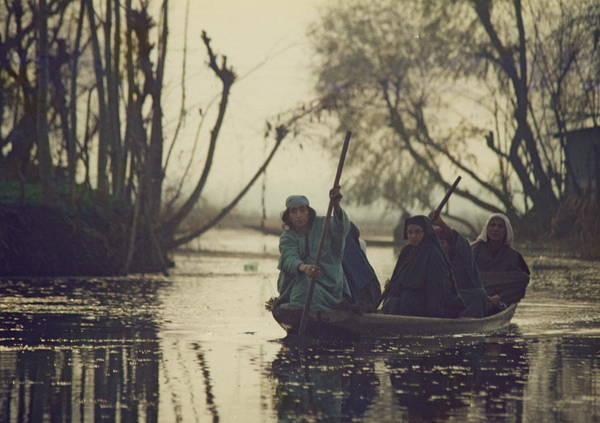Dal Lake Photograph - 5 Women In A Small Wooden Boat by Gila Rayberg
