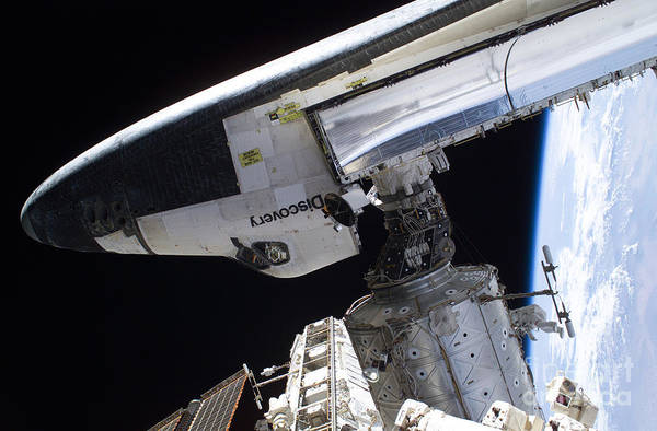Return To Earth Photograph - Space Shuttle Discovery by Nasa