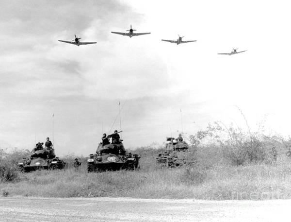 Battleground Photograph - A-1h Aircraft Make A Low Level Pass by Stocktrek Images