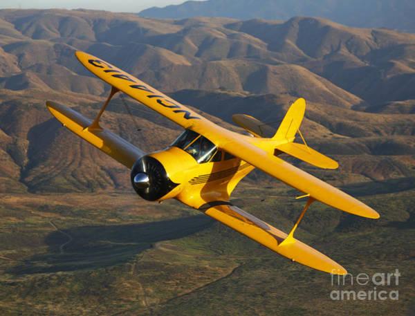Photograph - A Beechcraft Model B17r Staggerwing In Flight by Scott Germain