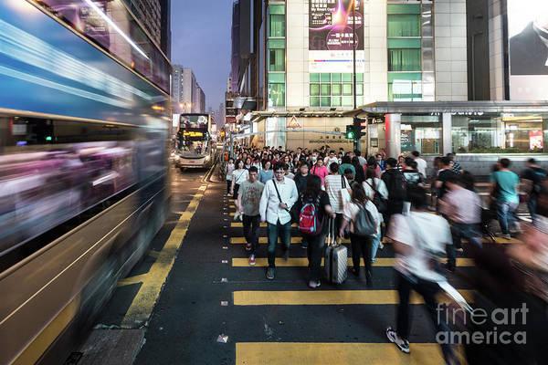 Photograph - A Bus Rushing Through Mongkok In Hong Kong by Didier Marti