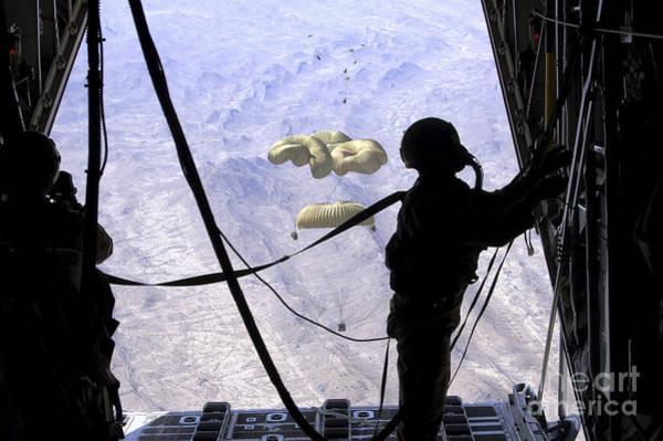 C 130 Photograph - A C-130 Hercules Loadmaster Observes by Stocktrek Images