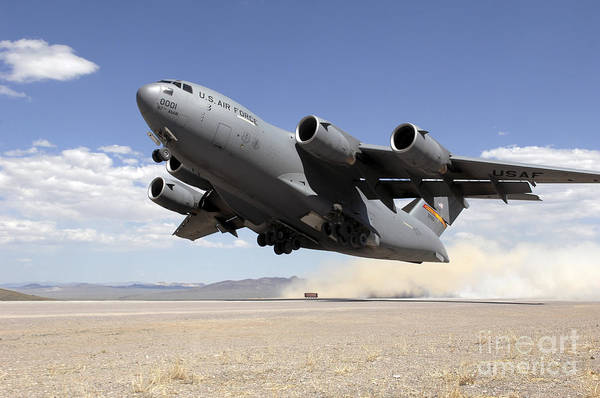 Military Air Base Photograph - A C-17 Globemaster Departs by Stocktrek Images