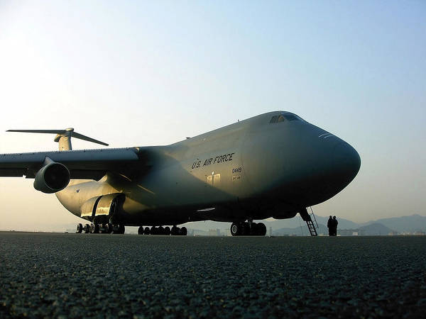National Guard Photograph - A C-5 Galaxy Sits On The Flightline by Stocktrek Images
