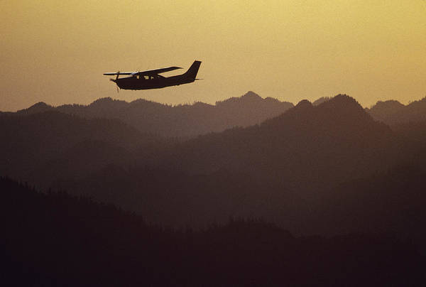 Timberline Photograph - A Cessna 210 Soars Above Olympic by Joel Sartore