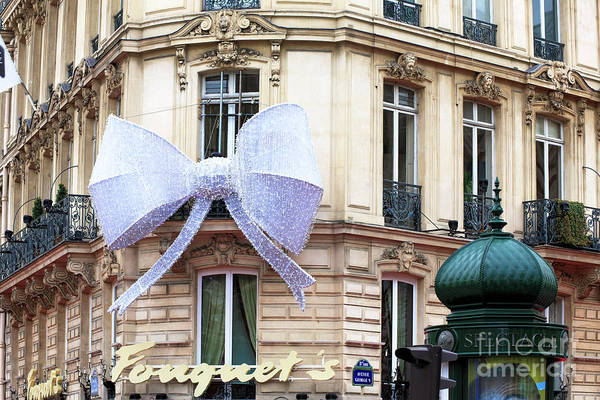 Photograph - A Christmas Bow On Fouquet's Paris by John Rizzuto