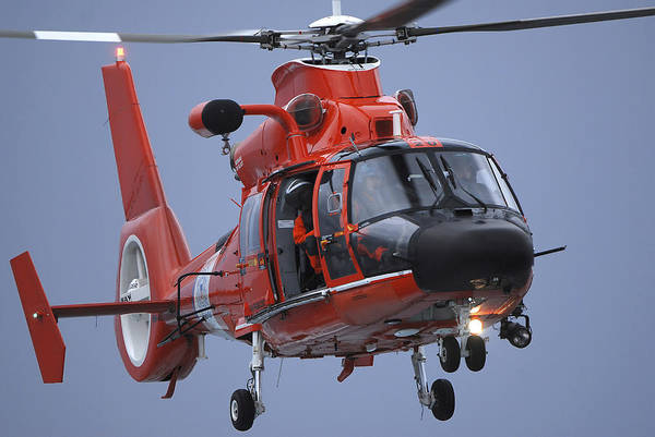 Photograph - A Coast Guard Mh-65 Dolphin Helicopter by Stocktrek Images
