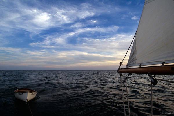 Aft Photograph - A Connie Dingy Follows A Classic Sailboat by John Harmon