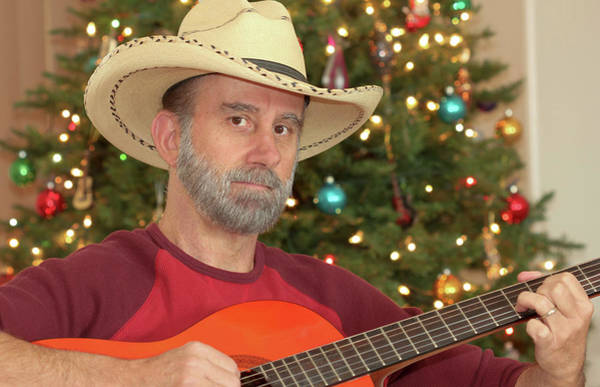 Wall Art - Photograph - A Cowboy With A Guitar By A Christmas Tree by Derrick Neill