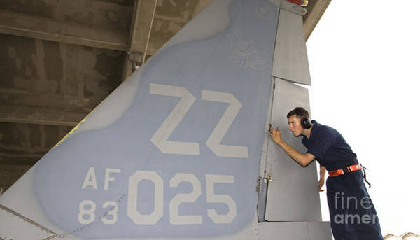 Military Air Base Photograph - A Crew Chief Conducts Postflight by HIGH-G Productions