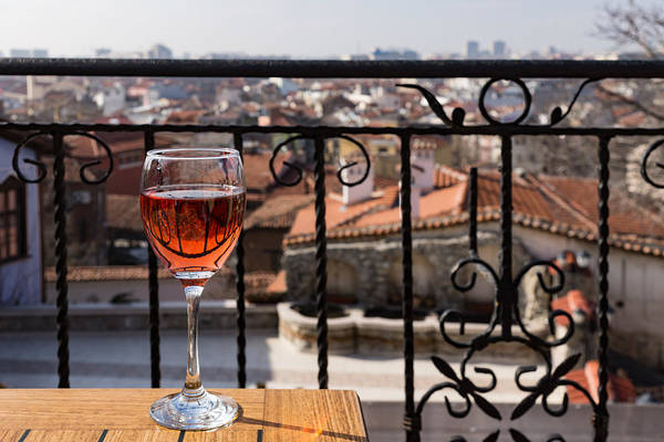 Photograph - A Dreamy Glass Of Rose - Enjoying A Fabulous View From A Wrought Iron Balcony by Georgia Mizuleva