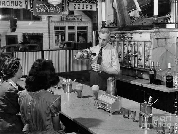 Photograph - A Druggist Prepares Ice Cream Floats At A Soda Fountain by B Anthony Stewart