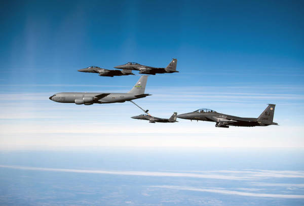 Aerial Combat Photograph - A F-15e Strike Eagle Is Refueled by Stocktrek Images