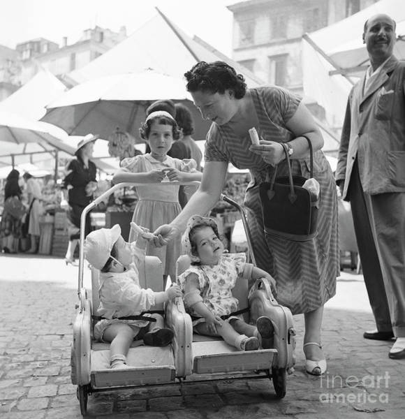 Wall Art - Photograph - A Family With Infants At An Open Air Market In Rome, 1955 by The Harrington Collection