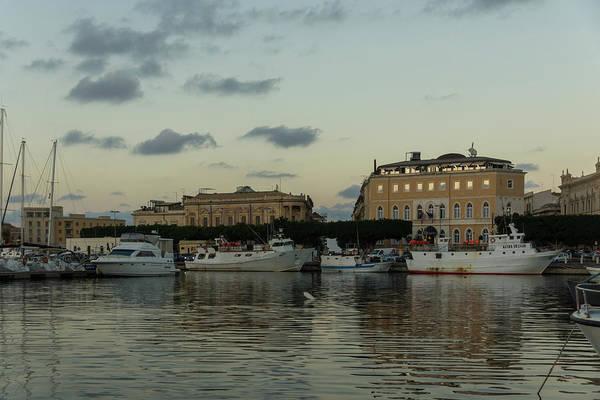 Photograph - A Fishing Port Surrounded By Palaces - Reflecting On Syracuse Sicily by Georgia Mizuleva