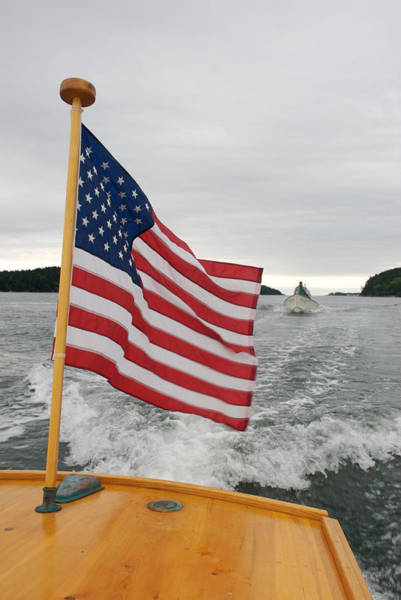 Aft Photograph - A Flag Waves On The Stern Of A Maine by Heather Perry