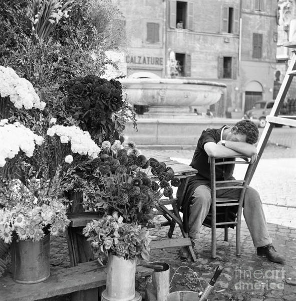 Wall Art - Photograph - A Flower Vendor Napping In A Plaza In Rome, 1955 by The Harrington Collection