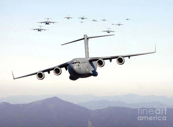C-17 Photograph - A Formation Of 17 C-17 Globemaster IIis by Stocktrek Images