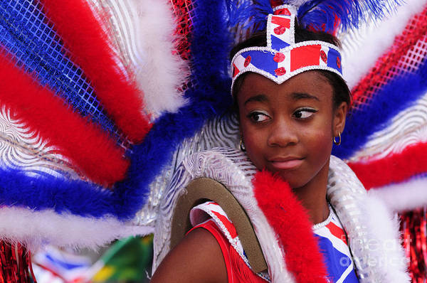 Blue Wall Art - Photograph - A Girl At The Notting Hill Carnival In London by Liz Pinchen