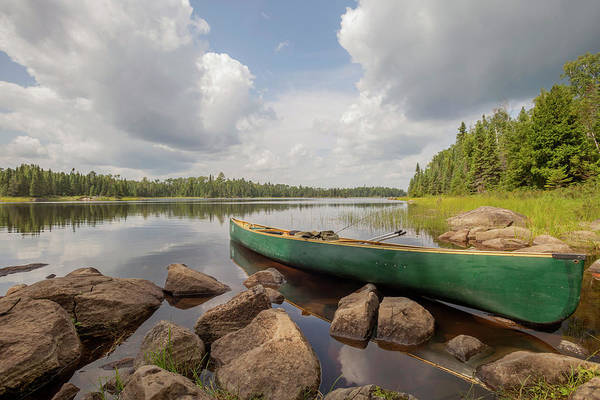 Bwcaw Photograph - A Green Canoe Rests At A Bwca Portage by Sam Wagner