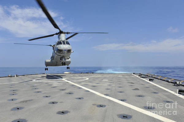 Helicopter Painting - A Helicopter Lands On The Deck Of Uss Pearl Harbor. by Celestial Images