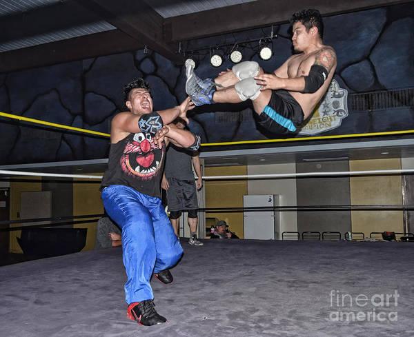 Pro Wrestler Wall Art - Photograph - A High Flying Drop Kick by Jim Fitzpatrick