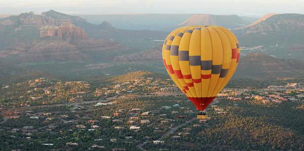 Wall Art - Photograph - A Hot Air Balloon Soars Above Sedona, Arizona by Derrick Neill
