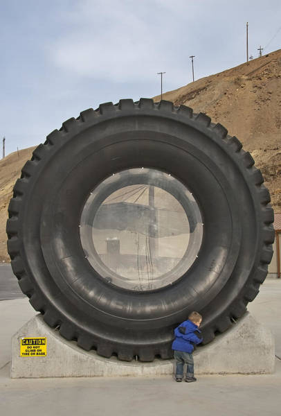 Wall Art - Photograph - A Kid And His Big Wheel by Steve Ohlsen