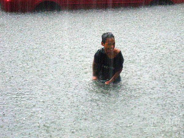 Photograph - A Kid In Tropical Storm Typhoon Ondoy by Christopher Shellhammer