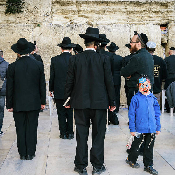 Photograph - A Little Boy Wearing A Mask Close To The Wailing Wall In Jerusalem, Israel by Alexandre Rotenberg