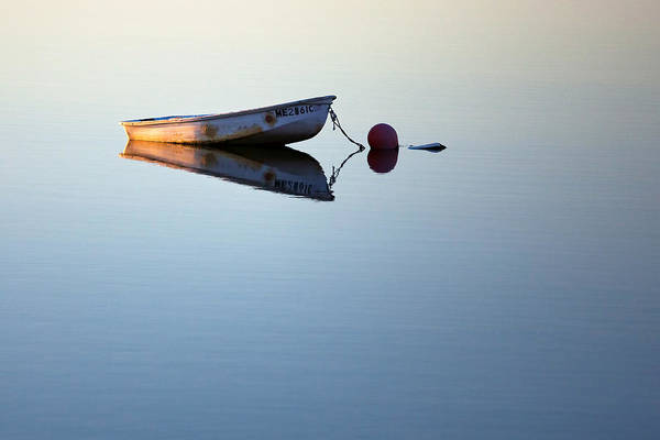 Wall Art - Photograph - A Lone Boat On Calm Waters by Eric Gendron