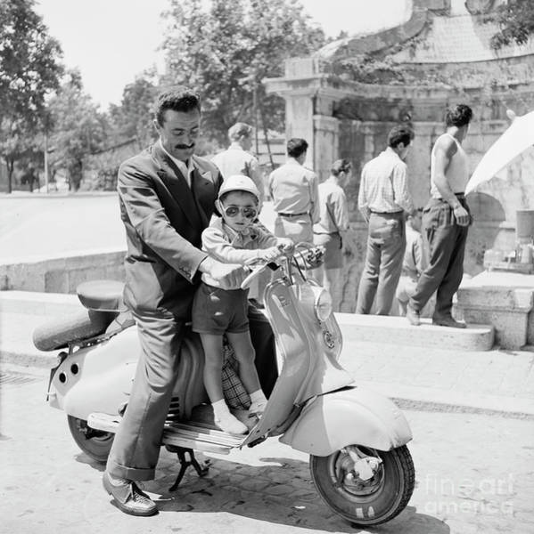 Wall Art - Photograph - A Man And His Son On A 1955 Lambretta Scooter, At A Fountain In  by The Harrington Collection