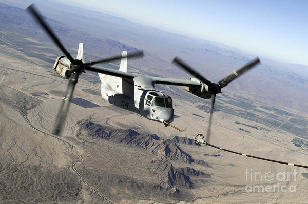Station To Station Photograph - A Marine Corps Mv-22 Osprey Prepares by Stocktrek Images