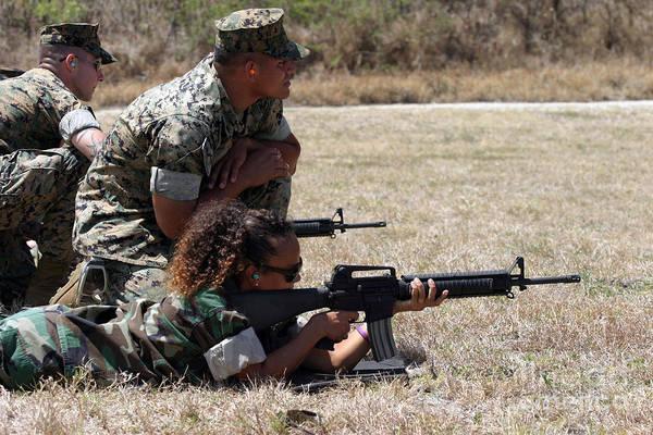Gunfire Photograph - A Marine Explains The Proper Techniques by Stocktrek Images