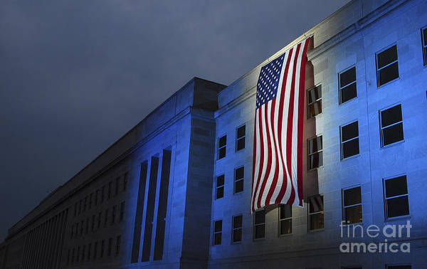 Wall Art - Photograph - A Memorial Flag Is Illuminated On The by Stocktrek Images