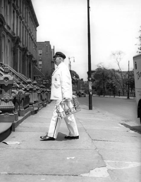 Wall Art - Photograph - A Milkman Delivering Milk by Underwood Archives