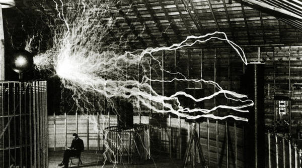 Voltage Photograph - A Multiple Exposure Picture Of Tesla With His Magnifying Transmitter by American School