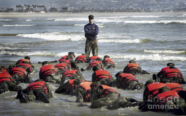 Navy Seal Photograph - A Navy Seal Instructor Assists Students by Stocktrek Images