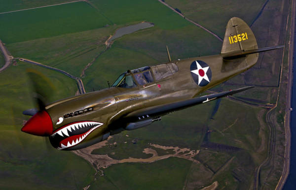 Airborne Photograph - A P-40e Warhawk In Flight by Scott Germain