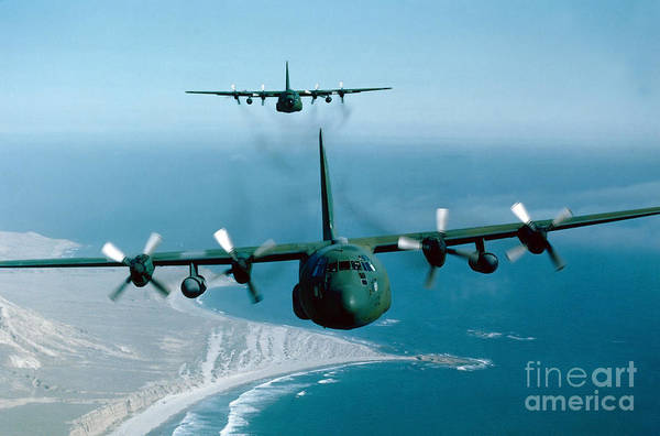 In Flight Photograph - A Pair Of C-130 Hercules In Flight by Stocktrek Images