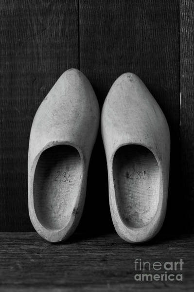 Wooden Shoe Photograph - A Pair Of Old Wooden Shoes by Edward Fielding